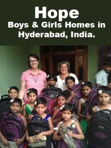 Photo of boys and girls with new backpacks, along with Shari Quackenbush and Marsha Weber