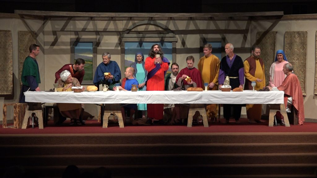 Living Last Supper 2016. This photo is of the entire cast, except Judas, as Jesus performs the blessing on the cup.