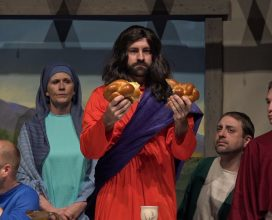 Dalton Shaffer portrays Jesus breaking the bread at the Last Supper