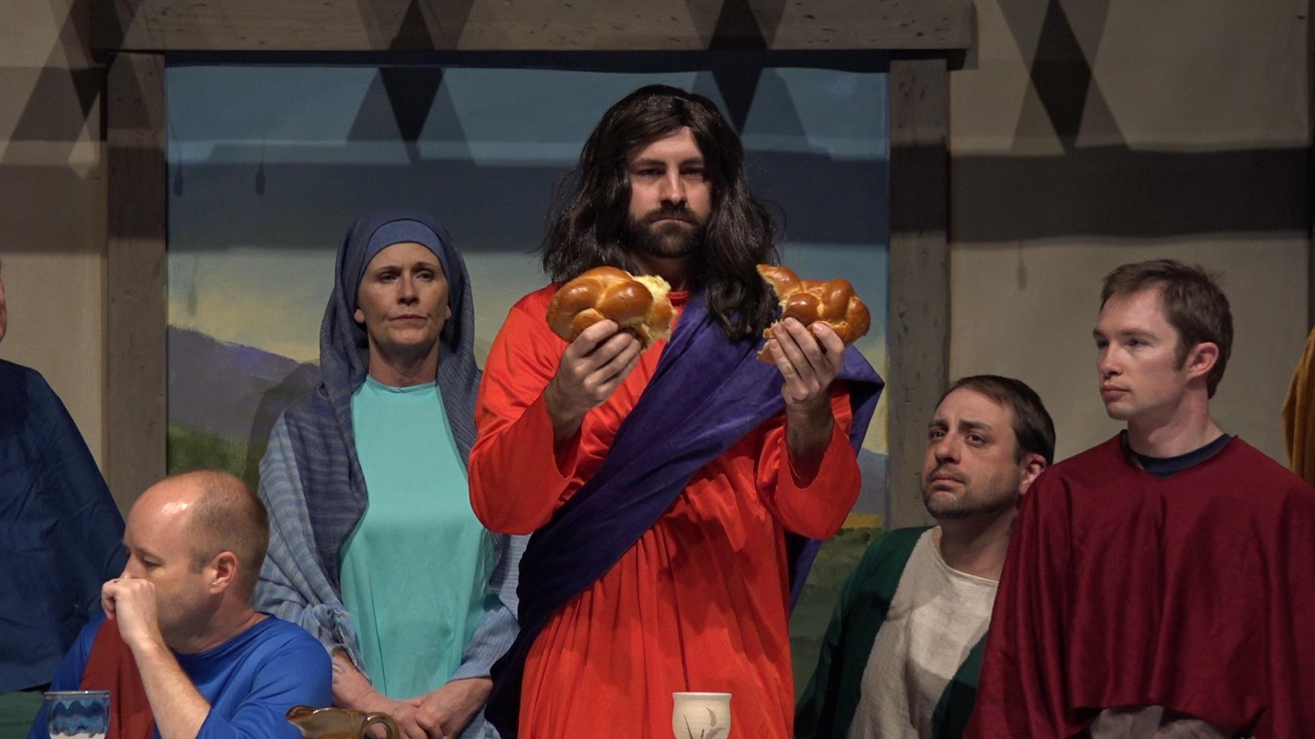 Dalton Shaffer portrays Jesus breaking the bread at the Last Supper