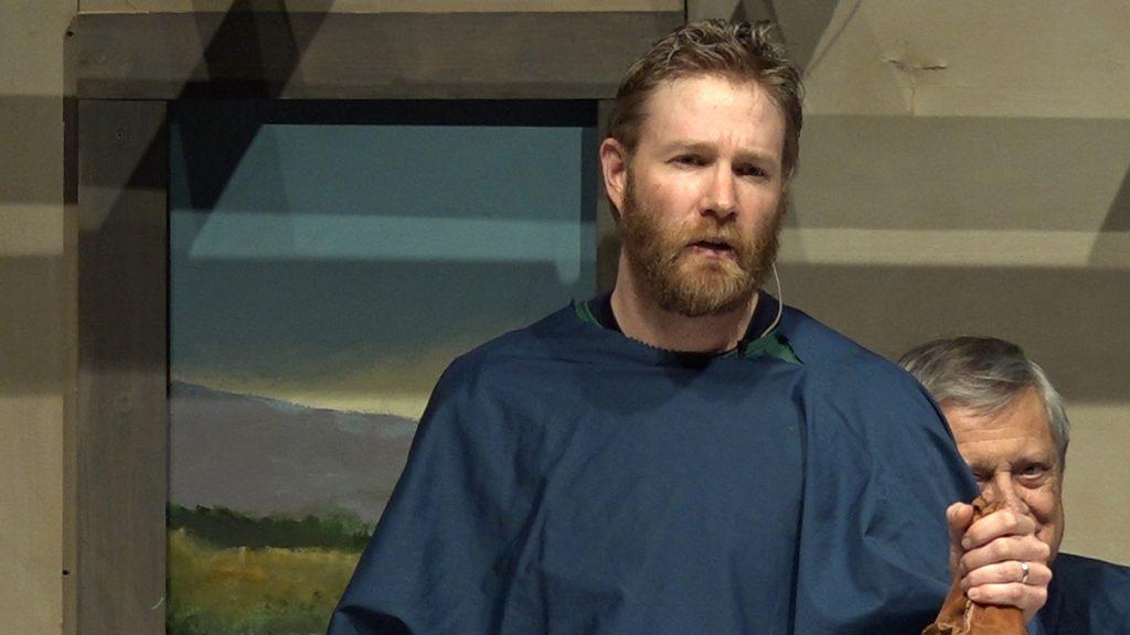 Jason Anderson delivering the monologue of Judas.
