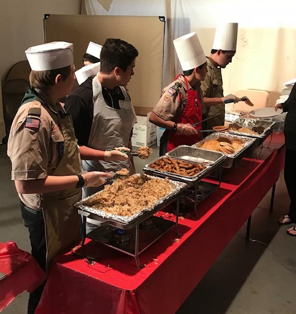 Boy Scouts serving breakfast